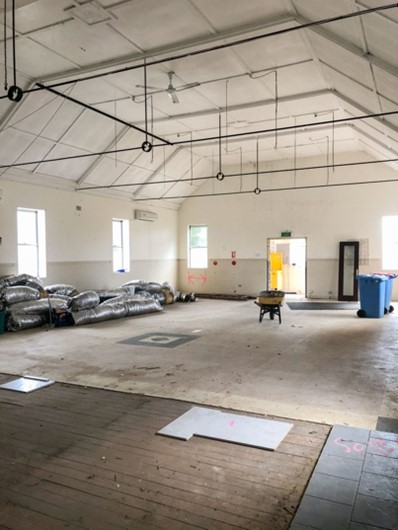 Hall with stage and carpet removed
